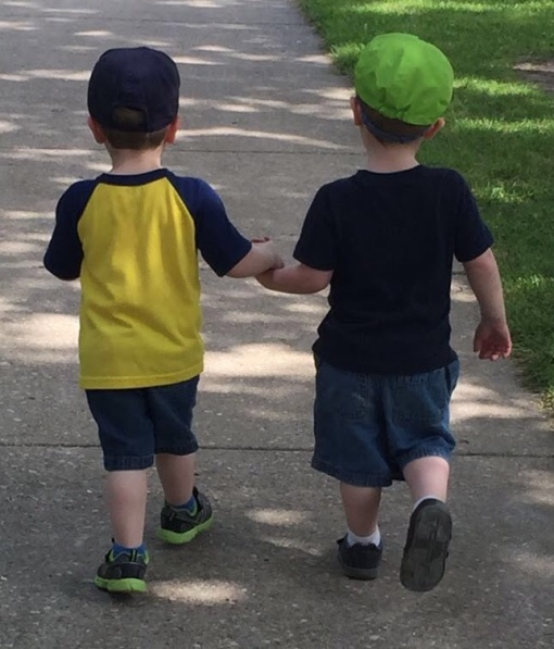 cohen twins walking down the street